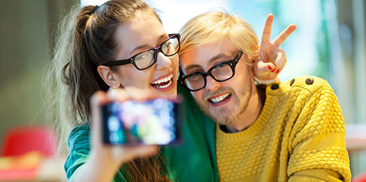 Couple in Glasses taking Selfies