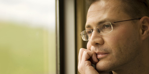 Man Thinking at Window