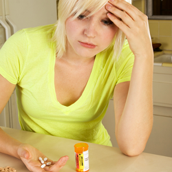 Young-Blond-Woman-With-Medicine