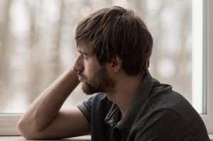 Man Sitting at the window thinking after taking Buprenorphine