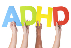 People holding the letters ADHD
