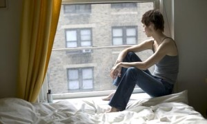 Woman In College Looking Out Her Window As She Thinks About Her Addiction To Adderrall - Addiction Hope