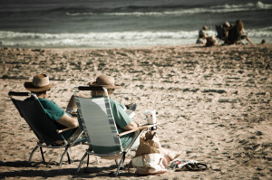 An old couple relaxing on the beach
