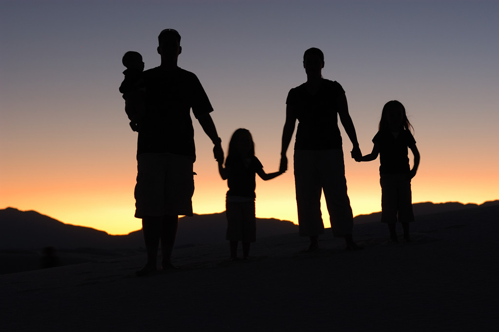 Family holding hand During a sunset