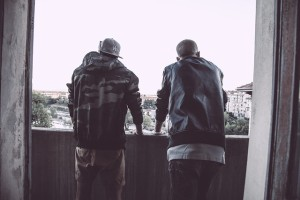 Two guys looking over a balcony