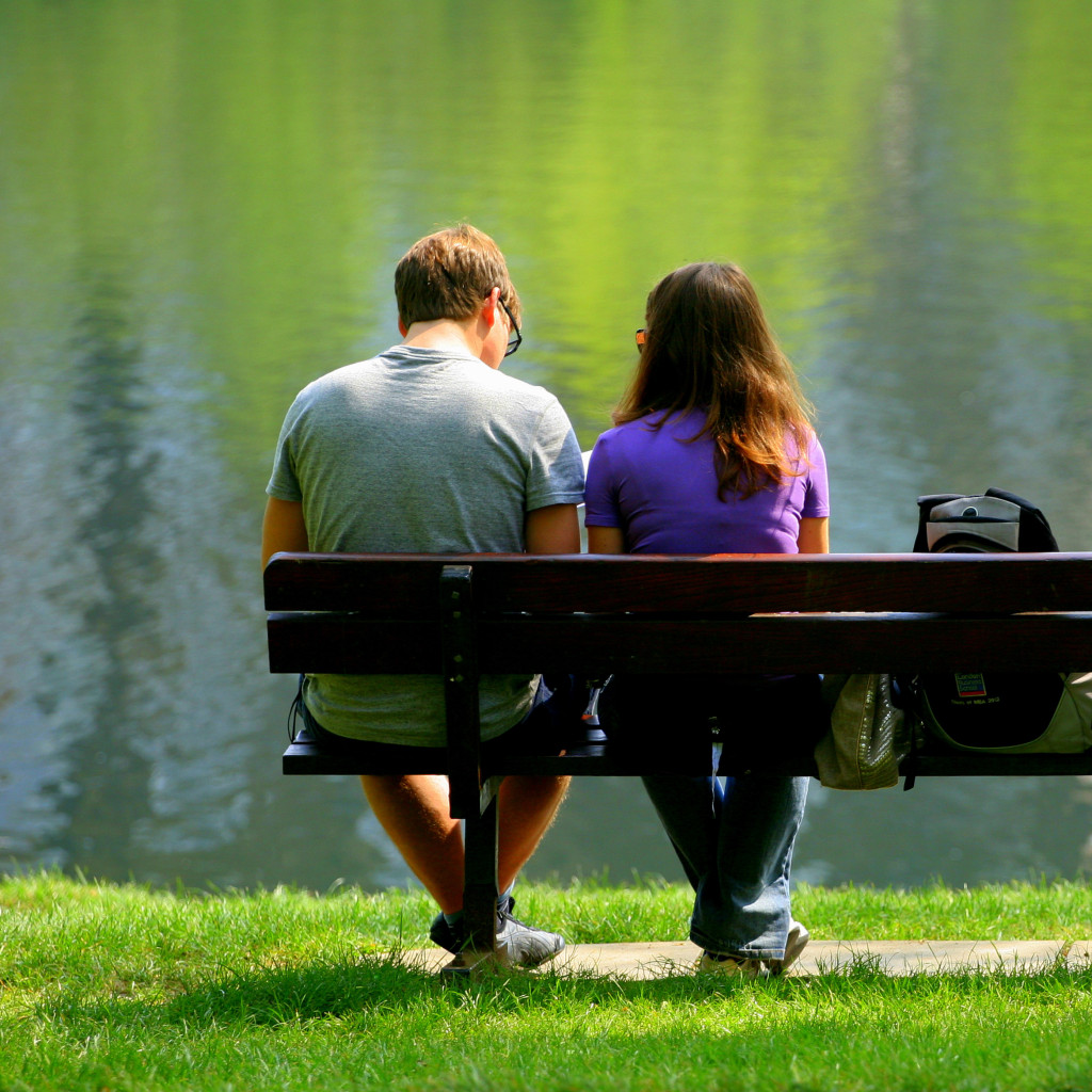 Man In Prescription Drug Addiction Treatment Sitting On A Bench With His Wife