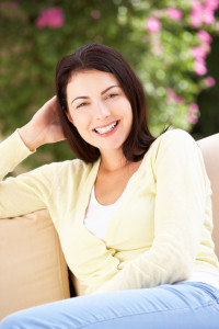 Woman in Addiction Recovery Relaxing On Sofa At Home