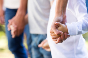 Family standing together helping a loved one with a substance use disorder