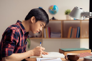 Young Asian man working with ADHD