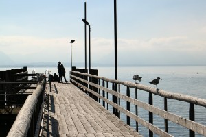 person walking on a pier pleased with Addiction Support Groups