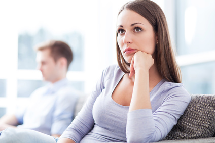 Woman thinking about shattered relationship