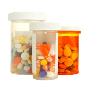 Group of three medicine bottles and learning to Dispose of Unused Prescription Drugs
