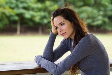Woman contemplating her Chronic Kidney Disease