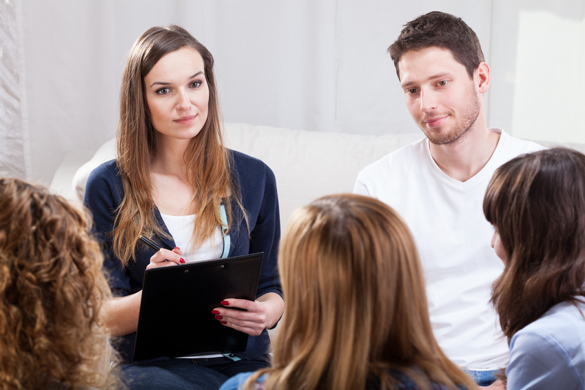 Group of young people during psychotherapy, horizontal