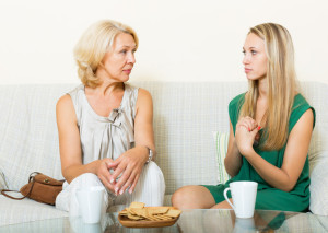 Mature woman with daughter having serious conversation