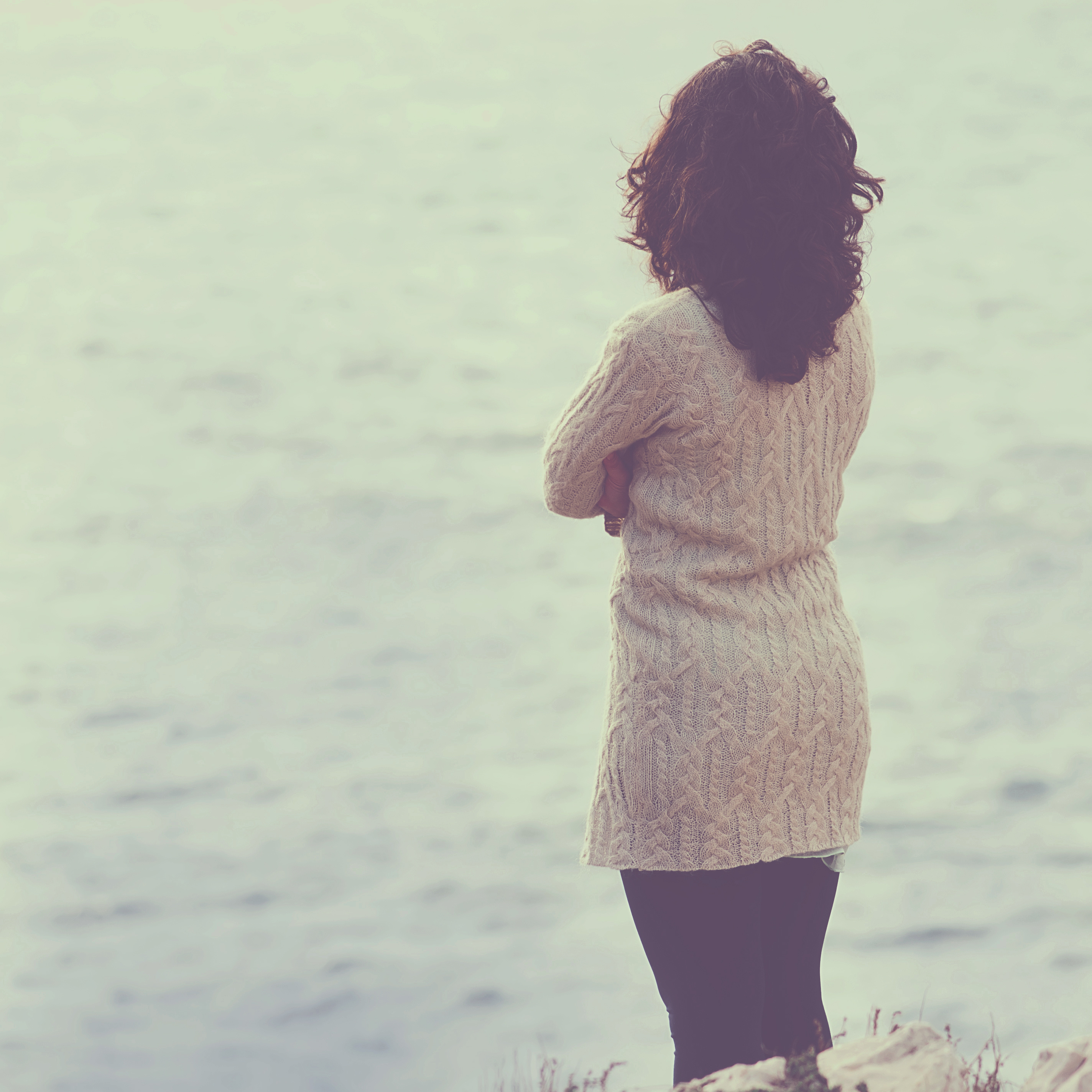 Woman looking out at the water and thinking about Prescription Stimulant Misuse