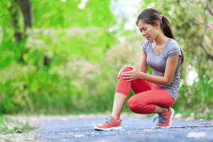 Knee Injury - sports running knee injuries on woman