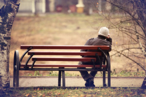 lonely man on the bench autumn, winter