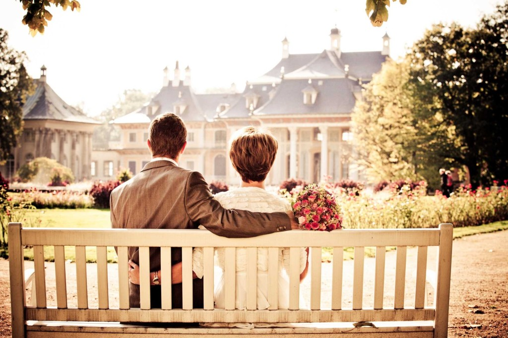 man and woman sitting on front porch swing