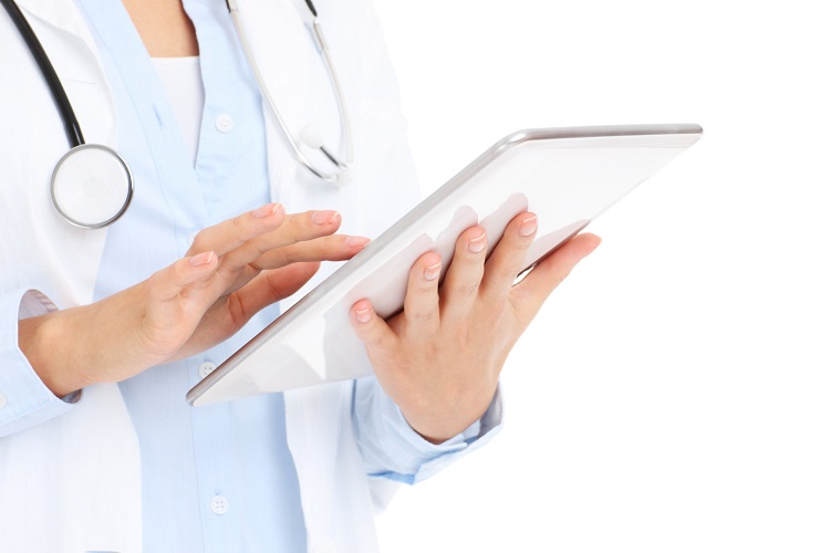 A picture of a doctor holding tablet over white background