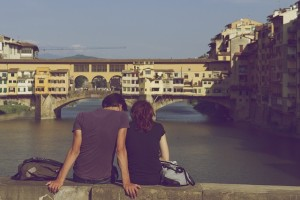 couple sitting on wall in rome