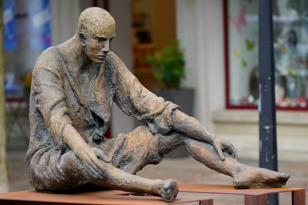Statue of man sitting