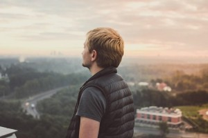 Young man looking into sky