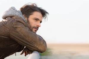 Man thinking about how to explain addiction treatment