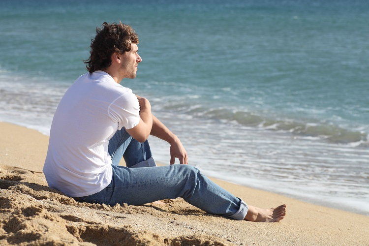 Man Sitting At The Beach preparing for rehab