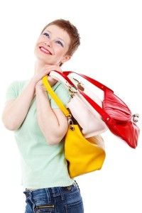 Lady Smiling with 3 Purses on Shoulder