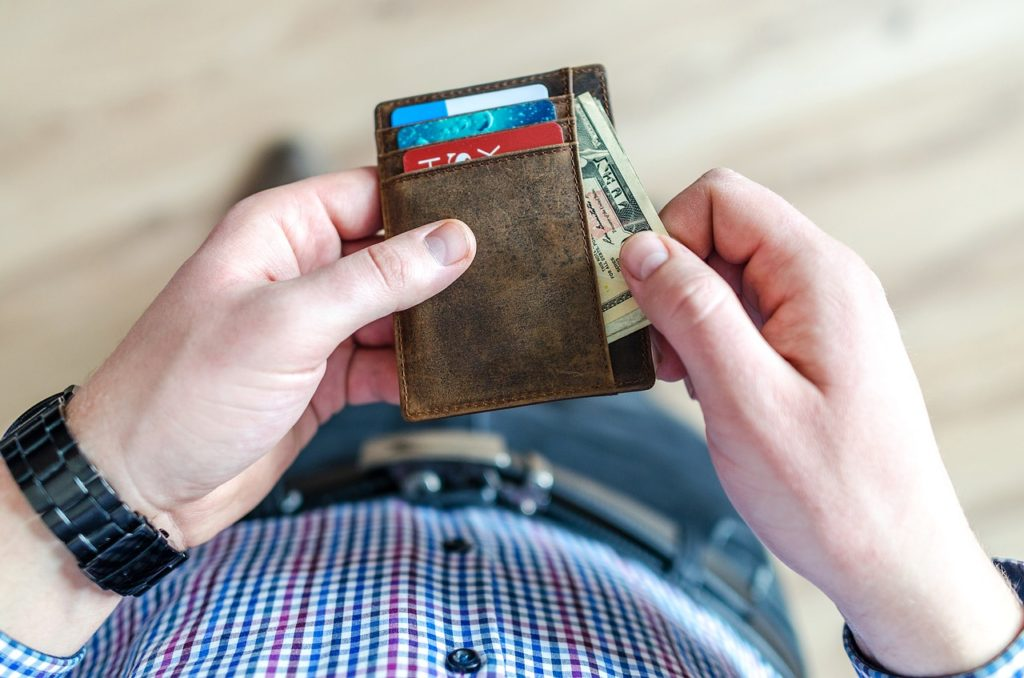 Man pulling money out of his wallet