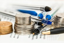 Pens and coins on Insurance paperwork