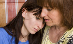 Mother Consoling Daughter After Discussing Tips for the Family on addiction recovery