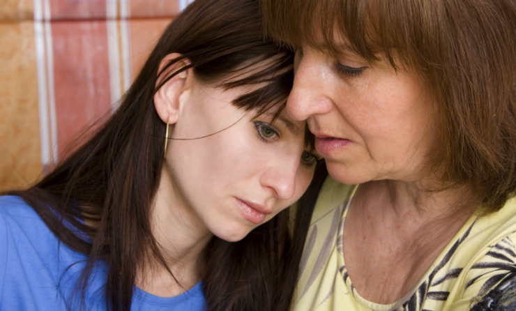 Mother Consoling Daughter After Discussing Misusing Prescription Drugs