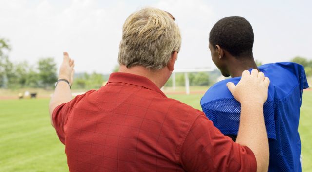 Coach Talking To Young Football Player - Addiction Hope