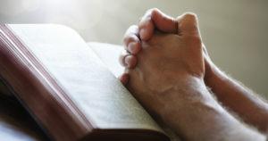 Man Praying and reading scripture