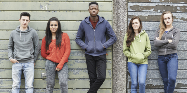 Group Of Male And Female Teenagers Not Smiling - Addiction Hope