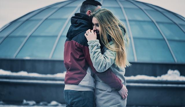 Husband hugging spouse struggling with a drug addiction