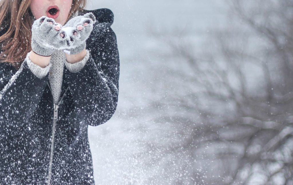Woman playing in the snow