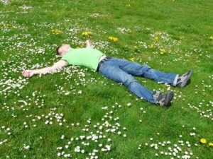 Man in grass for rest