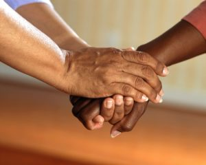 Holding hands of support