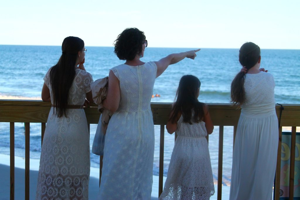 Mother and family looking at the ocean