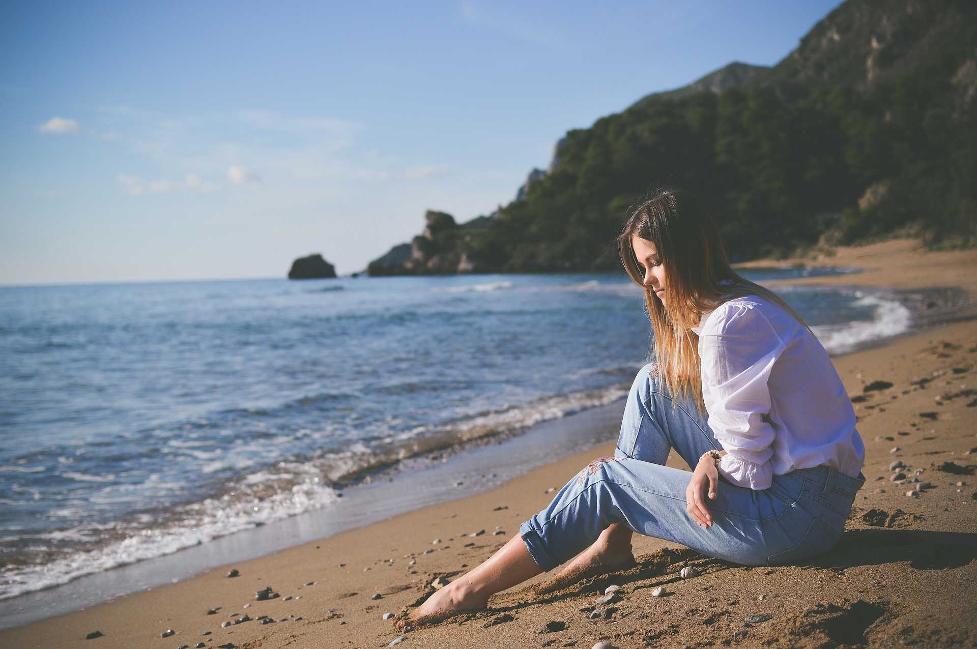 Woman sitting by the sea with opioid addiction