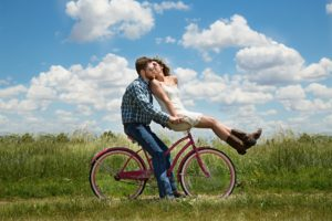 Couple in relationship on bike
