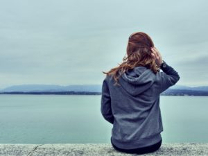 Woman on ledge thinking about Banning Fentanyl