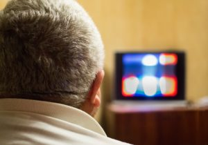 Man watching TV and recovering from a Klonopin Addiction