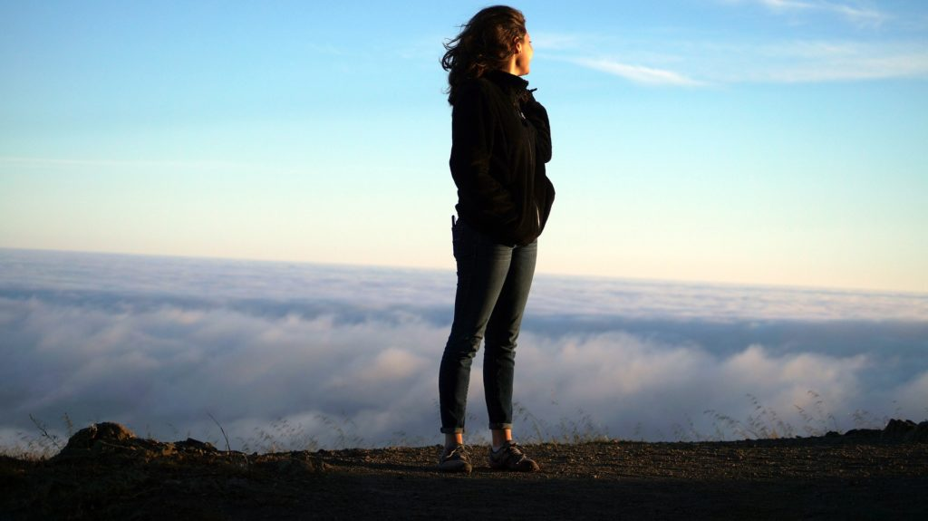 Woman on mountain thinking about her Process Addictions