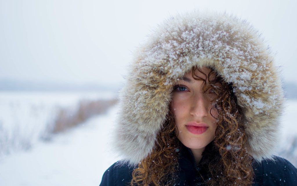 Woman in fur hat struggling with cocaine addiction