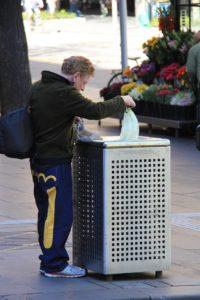 Man looking through garbage