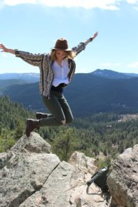 Woman jumping over rocks since she completed Treatment for Co-Occurring Disorders